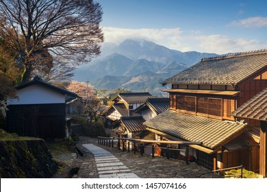 Magome juku preserved town in Nakasendo with central alps mountain at sunrise, Kiso valley in  Nakatsugawa, Gifu Prefecture, Japan. Famous travel landmark of old Japanese town.