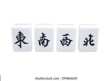 mah jong bricks on white with clipping path, the Chinese on the bricks from left to right means east, south, west, north, they refer to different directions of the wind