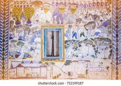 MAHA SARAKHAM, THAILAND - November 10, 2017: Ancient Thai Isan mural painting, The scenes of religion and life of people, at Wat Yang Tuang Wararam, Buddhist Temple in Borabu, Maha Sarakham, Thailand