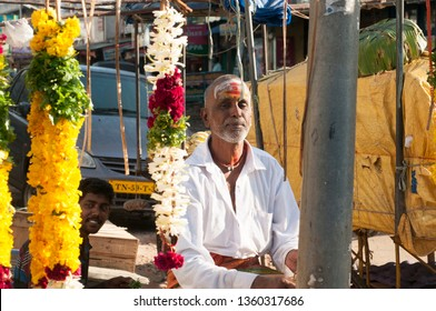 MAHABALIPURAM, TAMIL NADU, INDIA, 13 DECEMBER  2018 : Unidentified street vendor people selling various good on their shop at road of Mahabalipuram, An Indian scene.