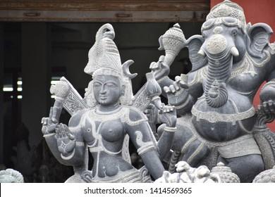 Mahabalipuram, Tamilnadu, India-November 2018:  Stone idols of hindu gods and godesses for sale outside idol manufacturing workshops in Mahabalipuram