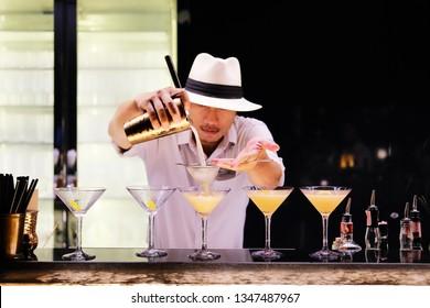 MAHANAKHON, BANGKOK - MAR 14: Bartender is making cocktail at Mahanakhon skywalk rooftop bar on march 14, 2019 in Bangkok.