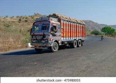 Maharashtra, India -January 5, 2012:  Colorful trucks brand TATA in Indian highway.