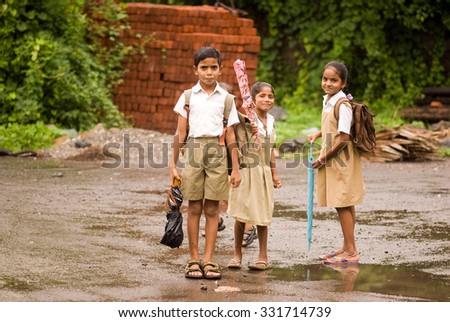 MAHARASHTRA, INDIA July 9, 2011: Fisherman children going to school in rainy days, July 9, 2011, Portuguese port Vasai, Mumbai, Maharashtra; India, Southeast, Asia.