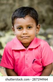 MAHARASHTRA, INDIA SEPTEMBER 22, 2011: Indian rural kid closeup, SEPTEMBER 22, 2011, rural village, Salunkwadi, Ambajogai, Beed, Maharashtra, India