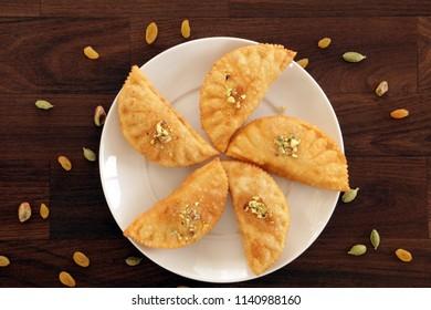 Karanjiis a maharashtrian deep fried sweet snack made for festival. Gujiya or Karanji is stuffed with sweetened grated coconut mixture.