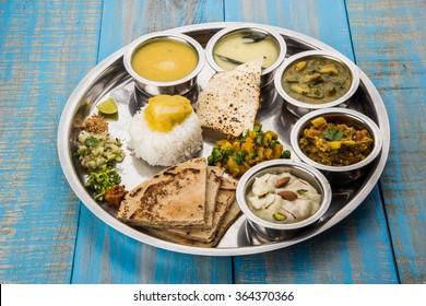 Veg thali images stock photos vectors shutterstock maharashtrian or marathi food platter pune mumbai konkan vidarbha food forumfinder Choice Image