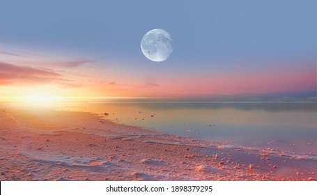 Maharlu pink salt lake with Full moon at sunset - Shiraz, Iran