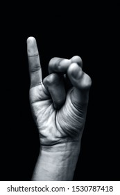 Mahasirs Mudra demonstrated by a single male hand isolated against a black background.