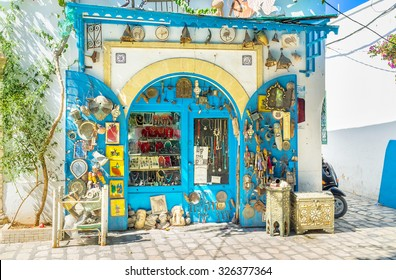 MAHDIA, TUNISIA - AUGUST 28, 2015: The small antique shop with the numerous old and new goods, that can be beautiful souvenirs, or perfect interior decorations, on August 28 in Mahdia.