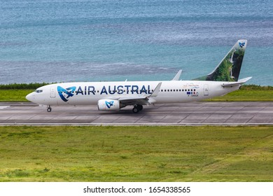 Mahe, Seychelles – February 9, 2020: Air Austral Boeing 737-800 airplane at Mahe airport (SEZ) in the Seychelles. Boeing is an American aircraft manufacturer headquartered in Chicago.
