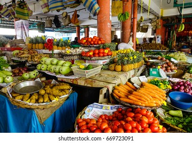 Mahebourg, Mauritius - Jan 14, 2017. Selling fresh fruits at rural market in Mahebourg, Mauritius. Mahebourg is a small city on the south-eastern coast of Mauritius.