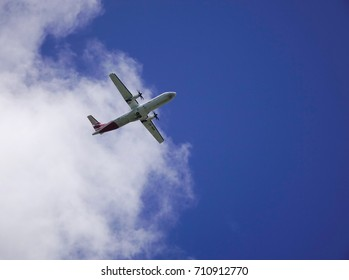 Mahebourg, Mauritius - Jan 15, 2017. A civil airplane flying away to the blue sky in Mauritius. Mauritius has an upper middle income economy according to the World Bank in 2011.
