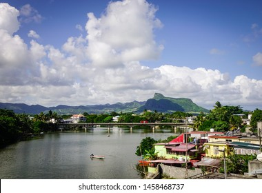 Mahebourg, Mauritius - Jan 3, 2017. River scene with many buildings on the bank in Mahebourg, Mauritius. Mahebourg is a small city on the south-eastern coast of Mauritius.