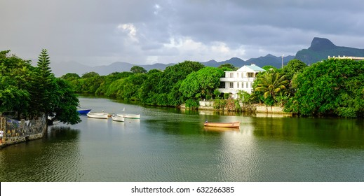 Mahebourg, Mauritius - Jan 5, 2017. River scene with many buildings on the bank in Mahebourg, Mauritius. Mahebourg is a small city on the south-eastern coast of Mauritius.
