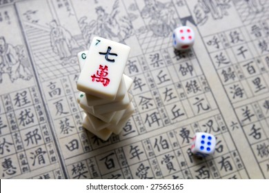 Mahjong - asian game with dices and hieroglyphical background
