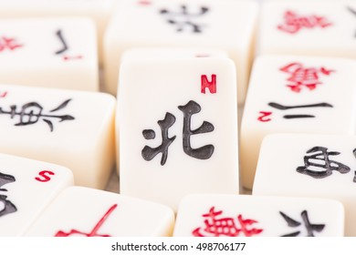 Mahjong board game pieces in close up. Concept of asian or chinese leisure activity, recreation and traditional games.