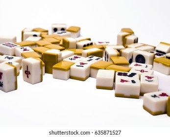Mahjong Tiles; jumbled group of mahjong tiles isolated on white ground; differential focus; good copy-space