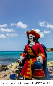 MAHO BAY BEACH, ST.MAARTEN -  AUGUST 01, 2015:  Captain Morgan statue standing and looking over famous Maho Bay Beach.