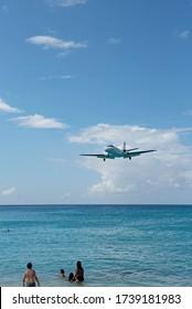 Maho Beach, Saint. Martin-January 9, 2019: Airplanes flying over the beach to Princess Juliana International Airport