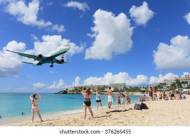 MAHO BEACH, ST MARTIN- NOV 24: Airplane is aproaching over maho beach, November 24, 2013