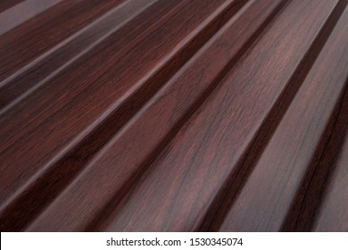 mahogany-colored metal sheets. steel profile imitating wood