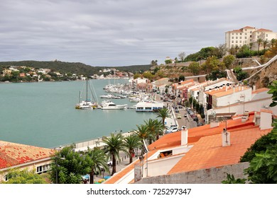 Mahon harbour in Minorca with fishing boats and yachts moored
