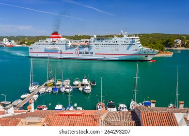 MAHON PORT, MENORCA ISLAND - JUN 21, 2012: ferry leaving port of Mahon on coast of Menorca island. Balearic Islands have a ferry transport which is popular among tourists.