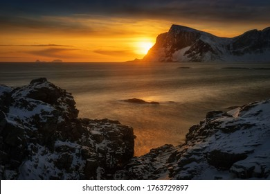 Mahornet summit and Vaeroy ridge at orange sunset, Lofoten Norway