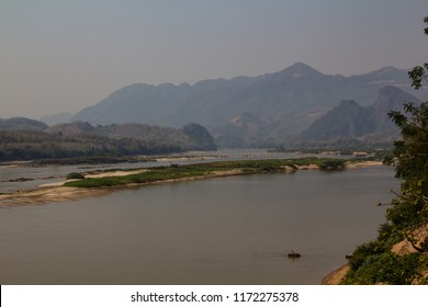 A mahout washing his elephant in the Mekong river in the democratic people's republic of Laos