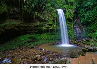Mahua Waterfall Tambunan Sabah. Nature jungle river and waterfall in Sabah Malaysia Interior with green vegetation.