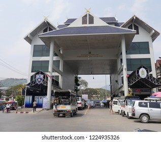 MAI SAI, THAILAND—MARCH 2018:  Cars slow down while crossing the border from Mai Sai to Myanmar