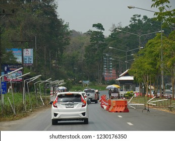 MAI SAI, THAILAND—MARCH 2018:  Cars slow down on the road for check points on the way to Mai Sai, the last city in northern Thailand.