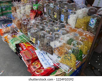 MAI SAI, THAILAND—MARCH 2018: Close up of assorted nuts and Thai delicacies in Mai Sai, the last city bordering Thailand and Myanmar.