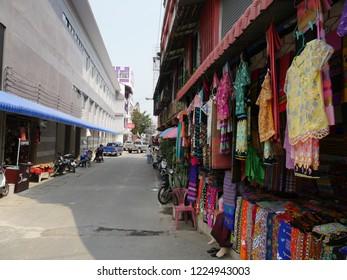 MAI SAI, THAILAND—MARCH 2018: Close up of stalls displaying colorful textile in Mai Sai near the Thai-Burmese gate.