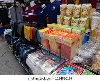 MAI SAI, THAILAND—MARCH 2018: Close up of Thai delicacies and clothes for sale at a shop in Mai Sai, the last city bordering Thailand and Myanmar.