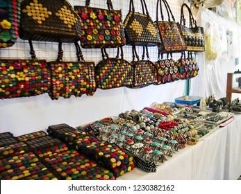 MAI SAI, THAILAND—MARCH 2018: Colorful assortment of purses and fashion jewelry in Mai Sai near the Thai-Burmese gate.
