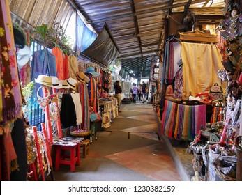 MAI SAI, THAILAND—MARCH 2018: Colorful displays of shawls, textile and other merchandise in Mai Sai near the Thai-Burmese gate.