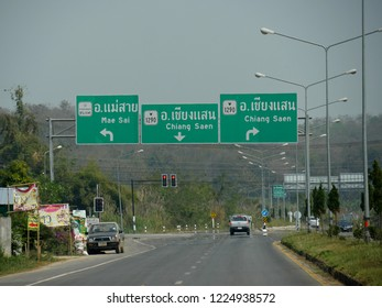 MAI SAI, THAILAND—MARCH 2018: Directional sign along an intersection with arrows pointing to the direction of Mae Sai and Chiang Saen.