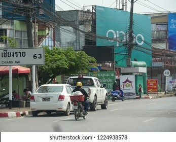 MAI SAI, THAILAND—MARCH 2018: Mess of wires and light traffic in Mai Sai, the last city bordering Thailand and Myanmar