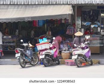 MAI SAI, THAILAND—MARCH 2018: Motorcycles parked outside a store in Mai Sai near the Thai-Burmese gate.