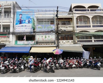 MAI SAI, THAILAND—MARCH 2018: Motorcycles parked along the road in front of buildings in Mai Sai, the last city bordering Thailand and Myanmar.