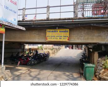 MAI SAI, THAILAND—MARCH 2018: Road under the bridge bordering Thailand and Myanmar in Mai Sai.