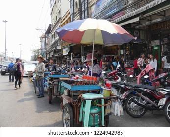 MAI SAI, THAILAND—MARCH 2018: Sidewalk vendors along the road in Mai Sai, the last city bordering Thailand and Myanmar.