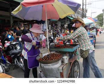 MAI SAI, THAILAND—MARCH 2018: Sidewalk vendors in Mai Sai, the last city bordering Thailand and Myanmar.