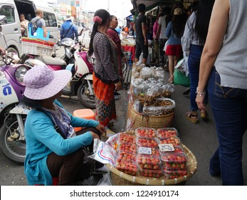 MAI SAI, THAILAND—MARCH 2018: Streetside vendors display fresh fruit, nuts and assorted  Thai delicacies in Mai Sai, the last city ordering Thailand and Myanmar.