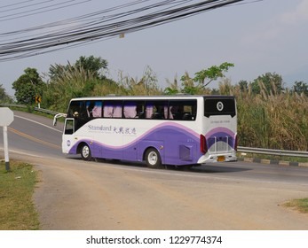 MAI SAI, THAILAND—MARCH 2018: A tour bus heads back to Mai Sai from the Golden Triangle in the northernmost part of Thailand.