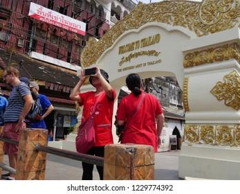 MAI SAI, THAILAND—MARCH 2018: Tourists take photos at the northernmost gate of Thailand in Mai Sai near the Thai-Burmese gate.