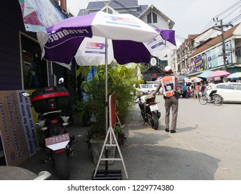 MAI SAI, THAILAND—MARCH 2018:  A traffic police conducts patrol by the roadside in Mai Sai, the last city in northern Thailand.