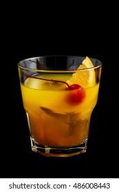 Mai Tai cocktail with orange and maraschino cherry garnish on black background